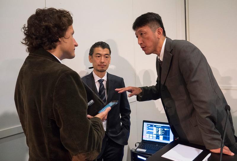 Dr. Atsushi Kobori, right, and Dr. Kazuaki Kaitano, center