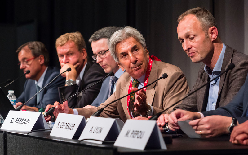 Roberto Ferrari leads a panel discusssion during the Servier Symposium