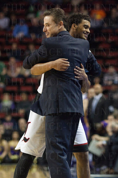 Head Coach Rick Pitino of the Louisville Cardinals hugs Quentin Snider (2) during the final seconds of their game against the Northern Iowa Panthers during the third round of the 2015 NCAA Men's Basketball Tournament at KeyArena on Sunday, March 22, 2015 in Seattle, Wash. Louisville won, 66-53.