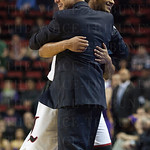 Head Coach Rick Pitino of the Louisville Cardinals hugs Quentin Snider (2) during the final seconds of their game against the Northern Iowa Panthers during the third round of the 2015 NCAA Men\'s Basketball Tournament at KeyArena on Sunday, March 22, 2015