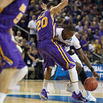 Terry Rozier (0) of the Louisville Cardinals ties to get around Jeremy Morgan (20) of the Northern Iowa Panthers during the third round of the 2015 NCAA Men\'s Basketball Tournament at KeyArena on Sunday, March 22, 2015 in Seattle, Wash. Louisville won, 6