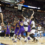 Montrezl Harrell (24) of the Louisville Cardinals reaches for a rebound against the Northern Iowa Panthers during the third round of the 2015 NCAA Men\'s Basketball Tournament at KeyArena on Sunday, March 22, 2015 in Seattle, Wash. Louisville won, 66-53.