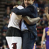Head Coach Rick Pitino of the Louisville Cardinals hugs Terry Rozier (0) during the final seconds of their game against the Northern Iowa Panthers during the third round of the 2015 NCAA Men's Basketball Tournament at KeyArena on Sunday, March 22, 2015 in Seattle, Wash. Louisville won, 66-53.