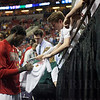 Montrezl Harrell (24) of the Louisville Cardinals autographs a shirt before playing against the Northern Iowa Panthers during the third round of the 2015 NCAA Men's Basketball Tournament at KeyArena on Sunday, March 22, 2015 in Seattle, Wash. Louisville won, 66-53.