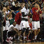 Mangok Mathiang (12) of the Louisville Cardinals cheers from the bench  against the Northern Iowa Panthers during the third round of the 2015 NCAA Men\'s Basketball Tournament at KeyArena on Sunday, March 22, 2015 in Seattle, Wash. Louisville won, 66-53.