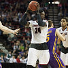 Montrezl Harrell (24) of  the Louisville Cardinals tooks to make a pass against the Northern Iowa Panthers during the third round of the 2015 NCAA Men's Basketball Tournament at KeyArena on Sunday, March 22, 2015 in Seattle, Wash. Louisville won, 66-53.