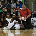 Montrezl Harrell (24) of the Louisville Cardinals stretches his leg  with Head Trainer Fred Hina before resuming the game against the Northern Iowa Panthers during the third round of the 2015 NCAA Men\'s Basketball Tournament at KeyArena on Sunday, March