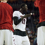 Mangok Mathiang (12) of the Louisville Cardinals talks to his teammates during a timeout against the Northern Iowa Panthers during the third round of the 2015 NCAA Men\'s Basketball Tournament at KeyArena on Sunday, March 22, 2015 in Seattle, Wash. Louisv