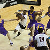 Terry Rozier (0) of the Louisville Cardinals drives to the basket while being defended by Paul Jesperson (4) and Marvin Singleton (12) in the first half against the Northern Iowa Panthers during the third round of the 2015 NCAA Men's Basketball Tournament at KeyArena on Sunday, March 22, 2015 in Seattle, Wash. Louisville won, 66-53.