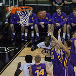 Mangok Mathiang (12) and Montrezl Harrell (24) of the Louisville Cardinals fight to grab a rebound against the Northern Iowa Panthers during the third round of the 2015 NCAA Men\'s Basketball Tournament at KeyArena on Sunday, March 22, 2015 in Seattle, Wa