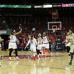 The Lady Cards celebrated the 3-point shot at the second quarter buzzer by Arica Carter ( center of the photo between Briahanna Jackson, # 23, and Erin Degrate, # 1).