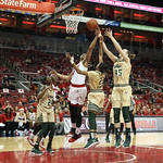 Louisville\'s Cortnee Walton vied for a rebound against South Florida\'s Shaleth Stringfield, # 23, and Katelyn Weber, # 45, during the fourth quarter.