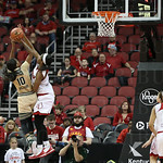 South Florida\'s Courtney Williams\' shot was blocked by Myisha Hines-Allen in the fourth quarter.