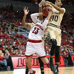Louisville\'s Briahanna Jackson was fouled by South Florida\'s Courtney Williams during second quarter play.