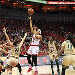 Louisville\'s Arica Carter took a short jump shot in the third quarter. Carter was one of four Cardinals to play in excess of 32 minutes. She scored 15 points and had 3 steals in the 67-50 victory against South Florida.