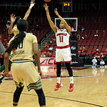 Arica Carter drilled this 3- point shot with 00.03 seconds left in the second quarter to give Louisville a 31-27 halftime lead over South Florida. The shot followed a defensive rebound by Louisville\'s Briahanna Jackson and a 30 - second Louisville timeou