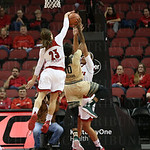 South Florida\'s Courtney Williams has her second quarter shot attempt blocked from behind by Louisville\'s Briahanna Jackson.