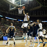 Wayne Blackshear (25) of the Louisville Cardinals taps in a basket against the UC Irvine Anteaters during the second round of the 2015 NCAA Men\'s Basketball Tournament at Key Arena on Friday, March 20, 2015 in Seattle, Wash. Louisville won, 57-55.