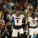 Terry Rozier (0) of the Louisville Cardinals defends against Alex Young (1) of the UC Irvine Anteaters during the second round of the 2015 NCAA Men\'s Basketball Tournament at Key Arena on Friday, March 20, 2015 in Seattle, Wash. Louisville won, 57-55.