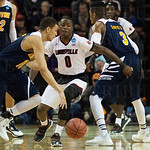 Terry Rozier (0) of the Louisville Cardinals defends against Luke Nelson (10) of the UC Irvine Anteaters during the second round of the 2015 NCAA Men\'s Basketball Tournament at Key Arena on Friday, March 20, 2015 in Seattle, Wash. Louisville won, 57-55.