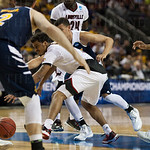Quentin Snider (2) of the Louisville Cardinals drops the ball while being guarded by the UC Irvine Anteaters during the second round of the 2015 NCAA Men\'s Basketball Tournament at Key Arena on Friday, March 20, 2015 in Seattle, Wash. Louisville won, 57-