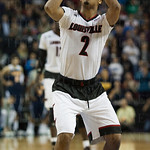 Quentin Snider (2) of the Louisville Cardinals shoots free throws late in the second half to put the Cardinals ahead against the UC Irvine Anteaters during the second round of the 2015 NCAA Men\'s Basketball Tournament at Key Arena on Friday, March 20, 20