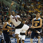 Terry Rozier (0) of the Louisville Cardinals is tripped up against the UC Irvine Anteaters during the second round of the 2015 NCAA Men\'s Basketball Tournament at Key Arena on Friday, March 20, 2015 in Seattle, Wash. Louisville won, 57-55.