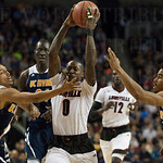 Terry Rozier (0) of the Louisville Cardinals drives to the basket  while being guarded by Jaron Martin (0) and Aaron Wright (32) of the UC Irvine Anteaters during the second round of the 2015 NCAA Men\'s Basketball Tournament at Key Arena on Friday, March