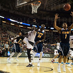 Alex Young (1) of the UC Irvine Anteaters grabs a rebound against the Louisville Cardinals during the second round of the 2015 NCAA Men\'s Basketball Tournament at Key Arena on Friday, March 20, 2015 in Seattle, Wash. Louisville won, 57-55.