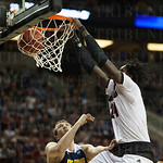 Montrezl Harrell the Louisville Cardinals slam dunks against the UC Irvine Anteaters during the second round of the 2015 NCAA Men\'s Basketball Tournament at Key Arena on Friday, March 20, 2015 in Seattle, Wash. Louisville won, 57-55.