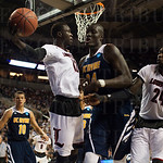 Mangok Mathiang (12) the Louisville Cardinals ftried to keep the ball in play while guarded by Mamadou Ndiaye (34) of the UC Irvine Anteaters during the second round of the 2015 NCAA Men\'s Basketball Tournament at Key Arena on Friday, March 20, 2015 in S