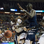 Mangok Mathiang (12) the Louisville Cardinals fights for a rebound against Mamadou Ndiaye (34) of the UC Irvine Anteaters during the second round of the 2015 NCAA Men\'s Basketball Tournament at Key Arena on Friday, March 20, 2015 in Seattle, Wash. Louisv