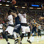 Montrezl Harrell (24) of the Louisville Cardinals makes a rebound against the UC Irvine Anteaters during the second round of the 2015 NCAA Men\'s Basketball Tournament at Key Arena on Friday, March 20, 2015 in Seattle, Wash. Louisville won, 57-55.