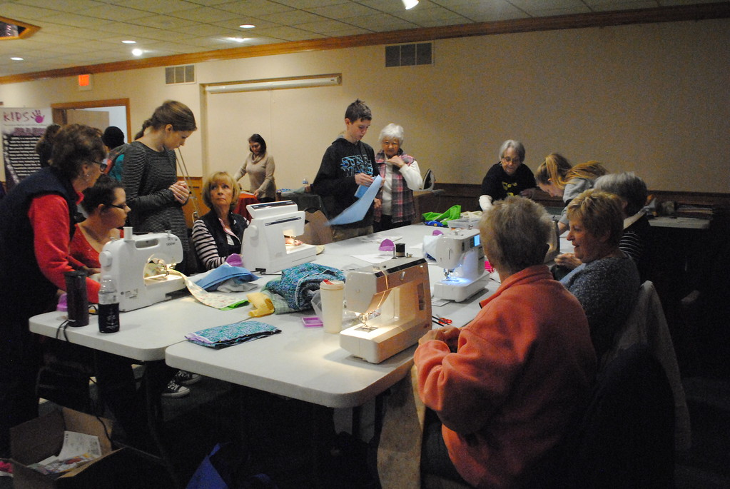 . Volunteers of all ages worked together in support of the Care Bag Movement\'s mission of providing a bag for every child taken into foster care in St. Clair and Sanilac counties. (Photos by Colleen Kowalewski)