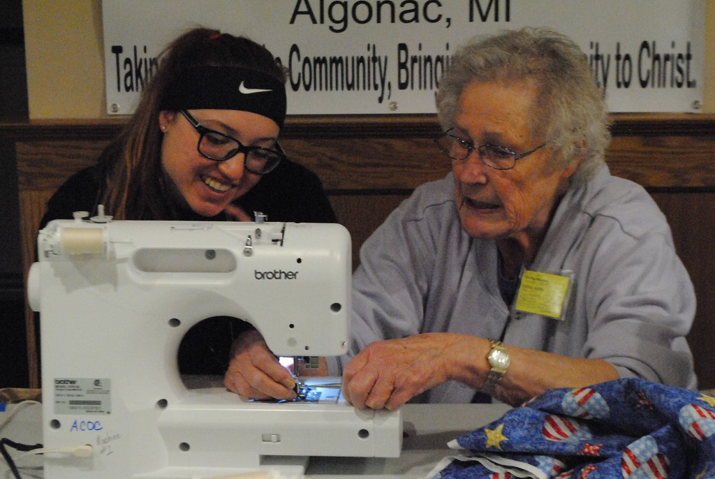 . Since its start in 2011, the Care Bag Movement has paired student leaders with mentors from the quilting group to organize the one-day event. (Photos by Colleen Kowalewski)