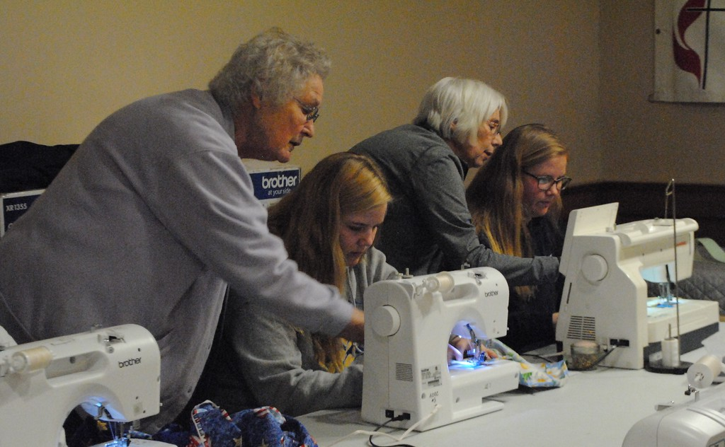. Experienced sewers offered instruction for beginners from Algonac High School who learned to sew as they made bags for children in need. (Photos by Colleen Kowalewski)