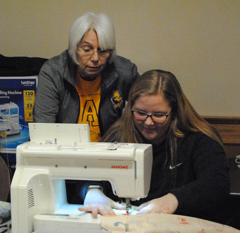 . Members of Piece to Peace Quilters helped Algonac High School students learn basic sewing skills to make care bags for children in need. (Photos by Colleen Kowalewski)