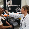 WesternU College of Optometry students, faculty and staff took part in a free mega-clinic, Care Harbor LA Friday, Nov. 15, 2019. Students and faculty from other colleges plan to participate over the weekend. Patient Deberal Cooley gets a vision screening from third-year student optometrist Yeraz Kocharian.<br /> (Jeff Malet, WesternU)