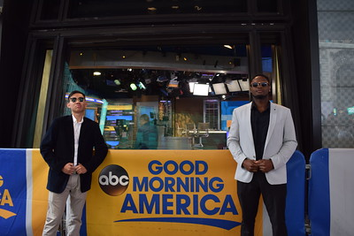 Kevin Le and Benji Osaije pose in front of Good Morning America Studios