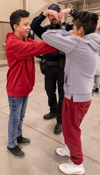 Kevin Botello, left, and Edgar Ruiz learn how to break a chokehold from the Estes Park Police Department during a career fair at the Estes Park Events Complex on Jan. 25.