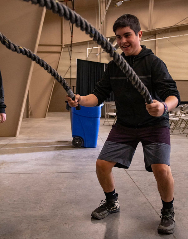 . Mateo Eggen Huerta, a seventh grader at Estes Park Middle School, gets a lesson in fitness from the Rocky Mountain Health Club during a career fair on Jan. 25.