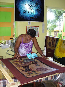 Making batik cloth - an ancient Indonesian art form - using wax and dyes.