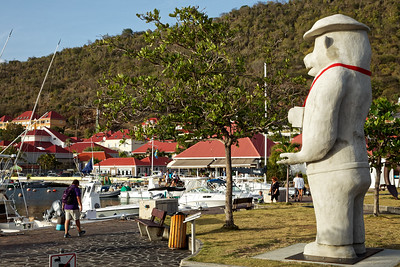 """On Columbus Circle in Gustavia, Saint Barthélemy, is a 15-foot-tall, two-and-a-half-ton concrete bear, a camera slung around his neck. Called """"Chronicle of the latter world"""" and inspired partly by a roadside sculpture in the Yukon, it's by the Polish-born, Brooklyn-based artist Joanna Malinowska"""
