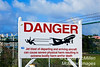 Warning sign at Sunset Café re: takeoffs from Princess Juliana International airport.