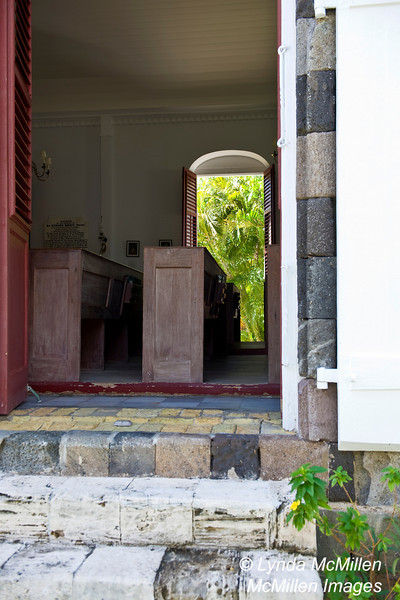 Louvered shutters and doors along the church's side walls creates natural ventilation.