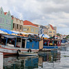 Floating market at the colourful UNESCO World Heritage Site of Willemstad