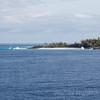 Caribbean sea waves splash against Half Moon Cay Island in Bahamas
