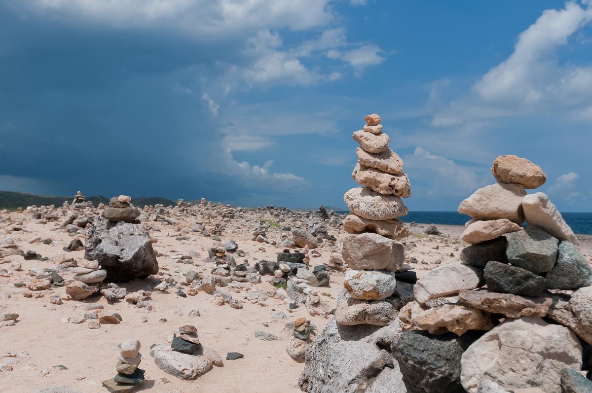 Wishing rocks stacked on a beach in Aruba