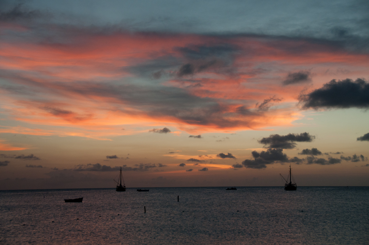 Sunset over sailboats in Aruba