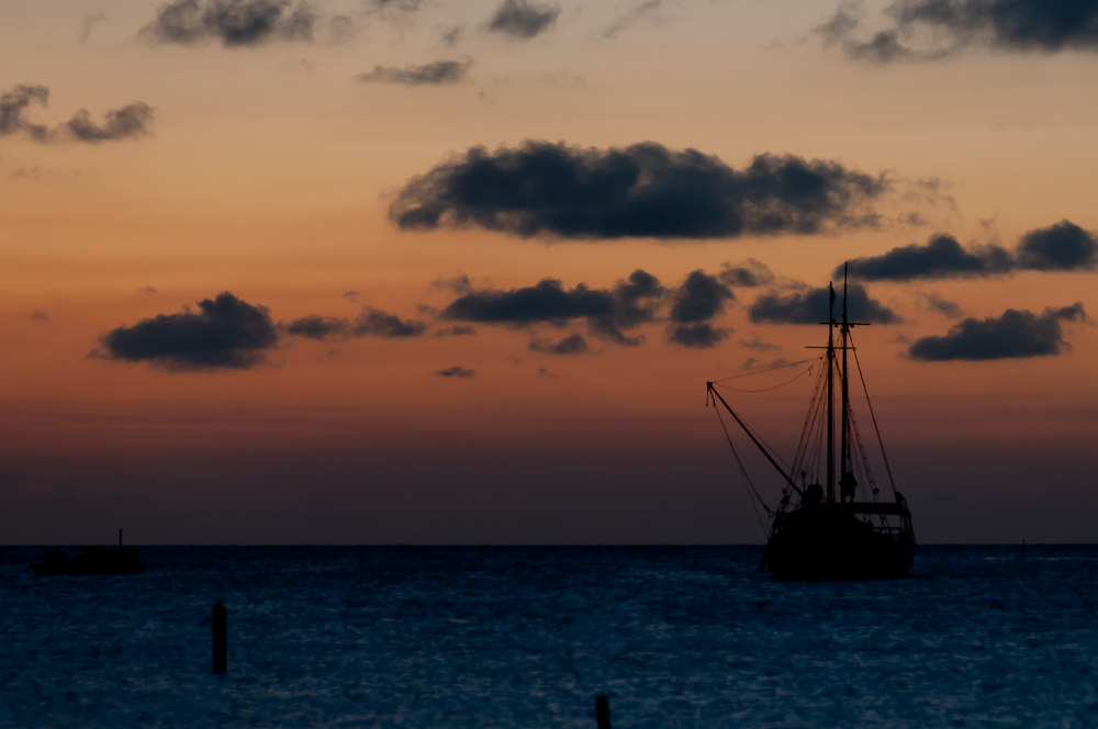 A sailboat at sunset on the island of Aruba